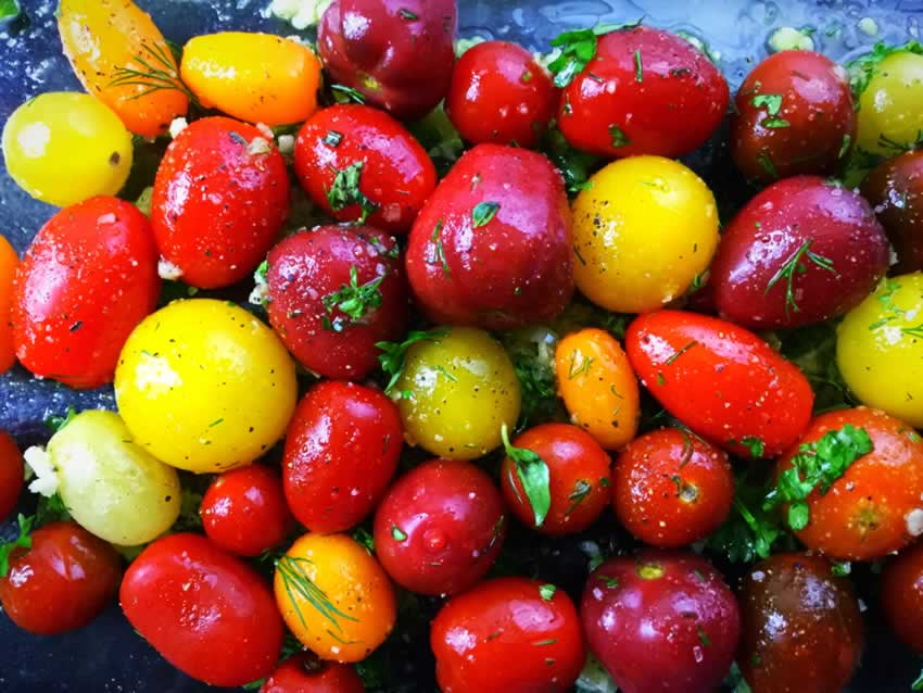 Heirloom tomatoes, garlic and fresh herbs tossed in olive oil