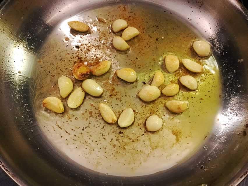 Sautéing the garlic cloves
