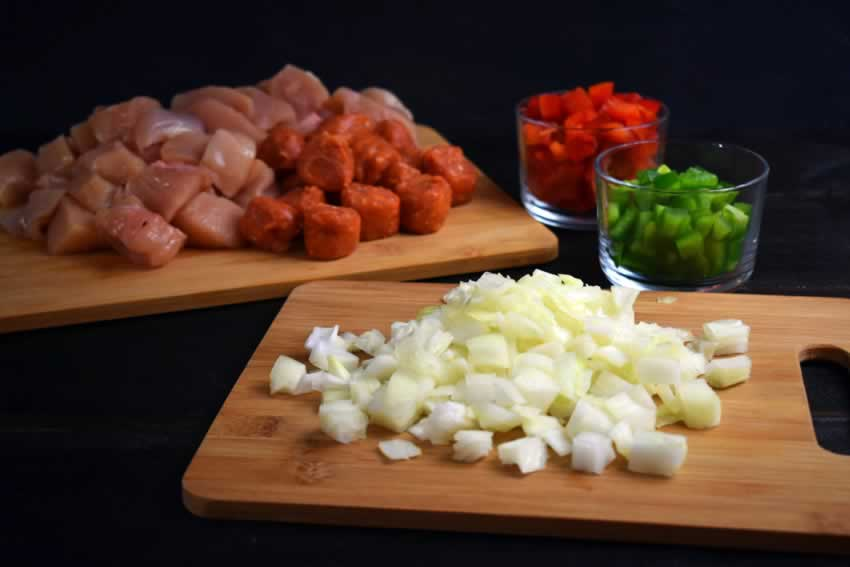 Chopped chicken, sausage, red and green bell pepper, and onion
