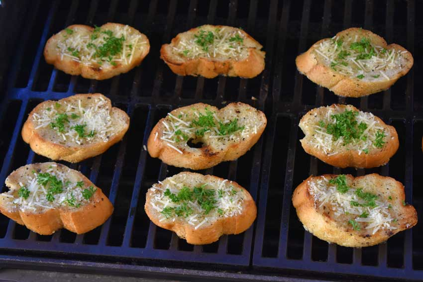 Toasting garlic bread on the grill