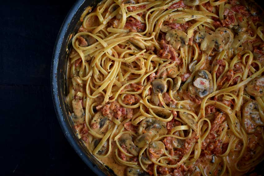 A pan of Sun Dried Tomato and Mushroom Pasta In a Garlic and Basil Sauce