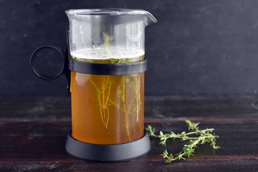 Making the honey thyme simple syrup