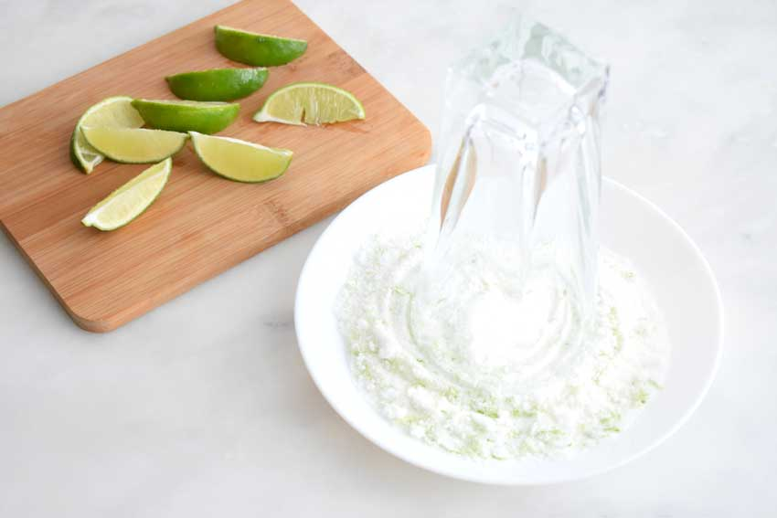 Rimming the glass with a mixture of sugar and lime zest
