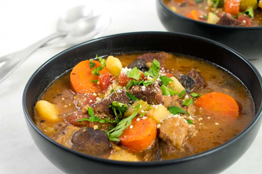 Italian Beef Stew garnished with parsley, basil, and parmesan cheese