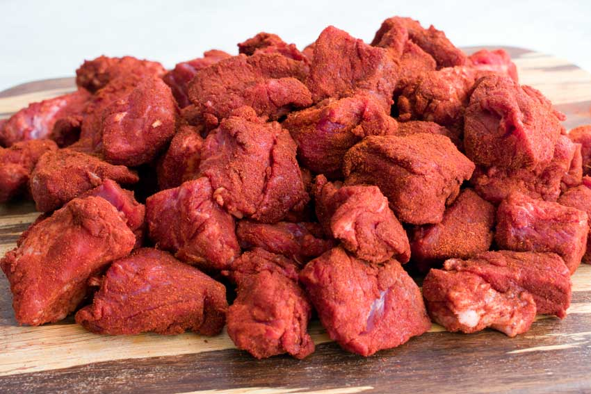 Beef chunks coated in a mixture of paprika and cayenne pepper