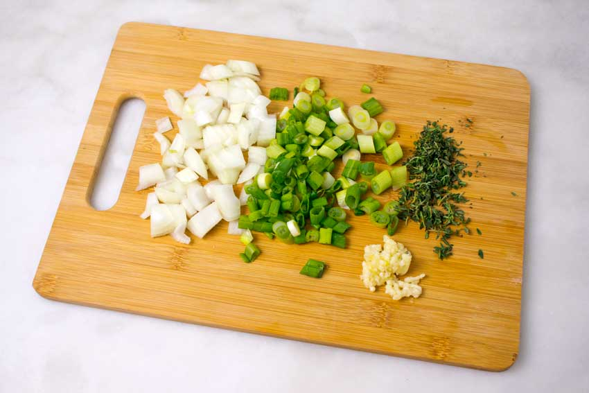 Chopped onion, chili peppers, thyme, and garlic