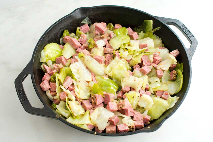Cooking the cabbage, onion, and corned beef