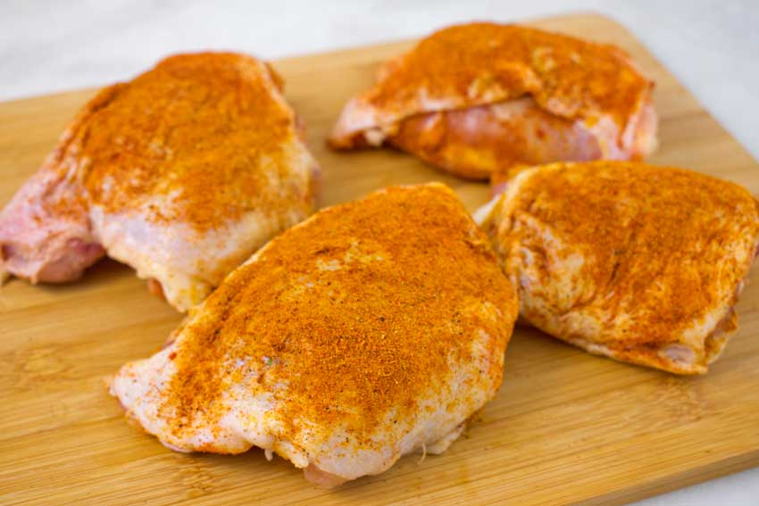 Chicken thighs seasoned with the spice mix