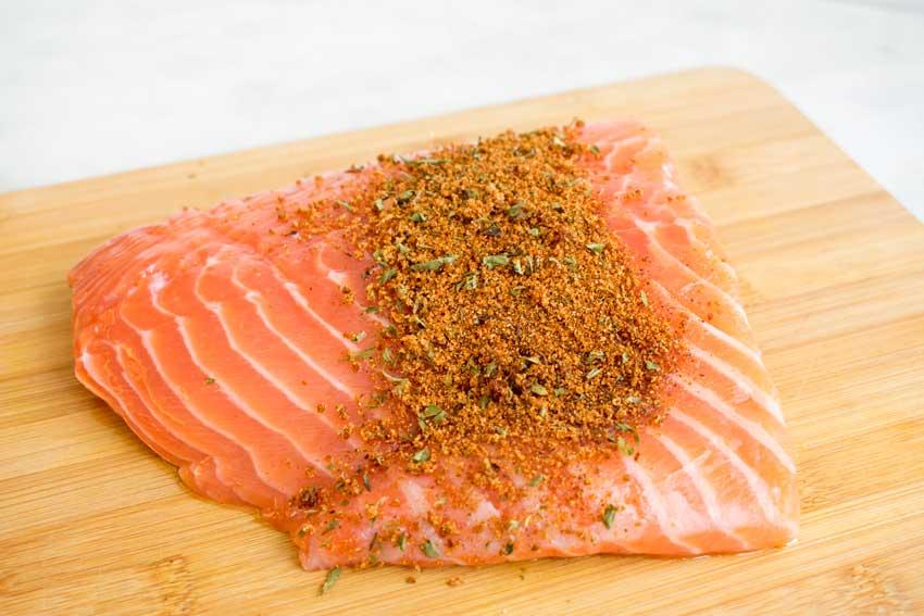 Seasoning the salmon fillet