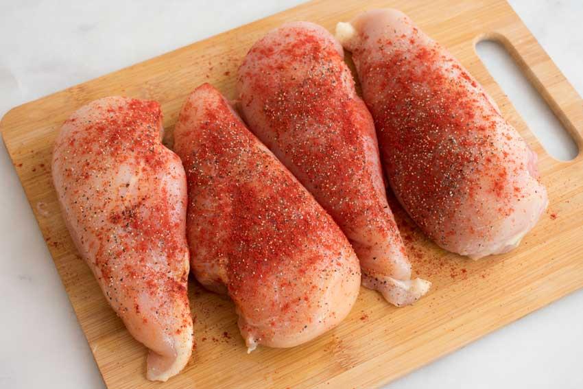 Seasoning the chicken breasts