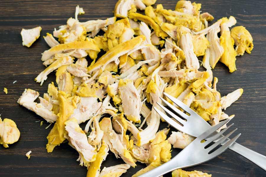 Shredding the chicken thighs