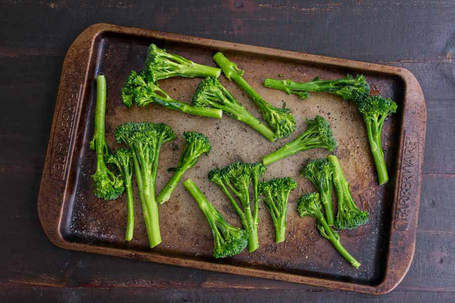 Broccolini tossed with olive oil and seasoned with salt and pepper