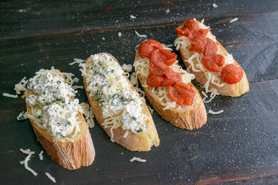 Adding the cheese and tomatoes to the bread