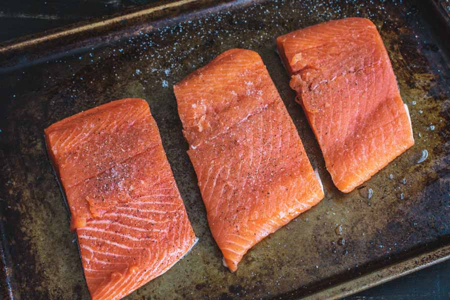 Salmon fillets seasoned with salt and pepper
