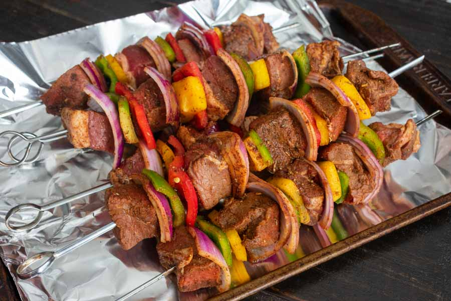 Skewers threaded with meat and vegetables just before grilling