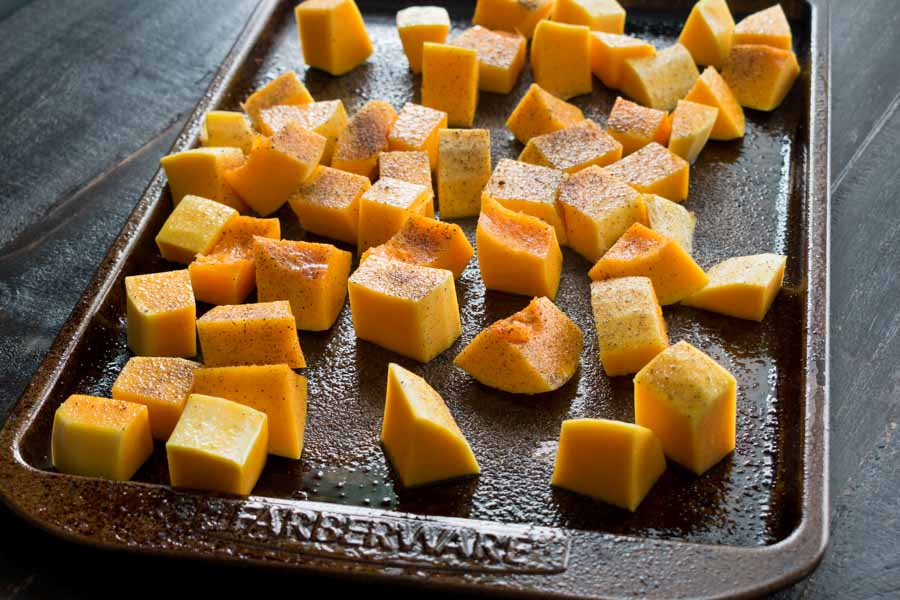Cubed butternut squash seasoned with nutmeg, salt, and pepper