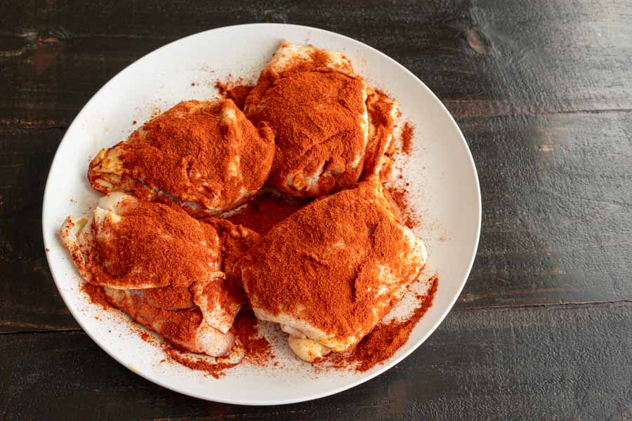 Chicken thighs sprinkled with paprika