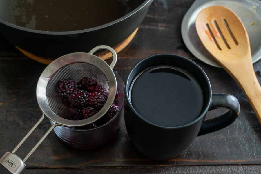 Straining the blackberry simple syrup