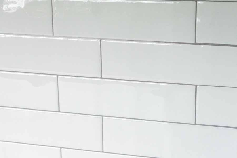 White stick-on subway tile backsplash