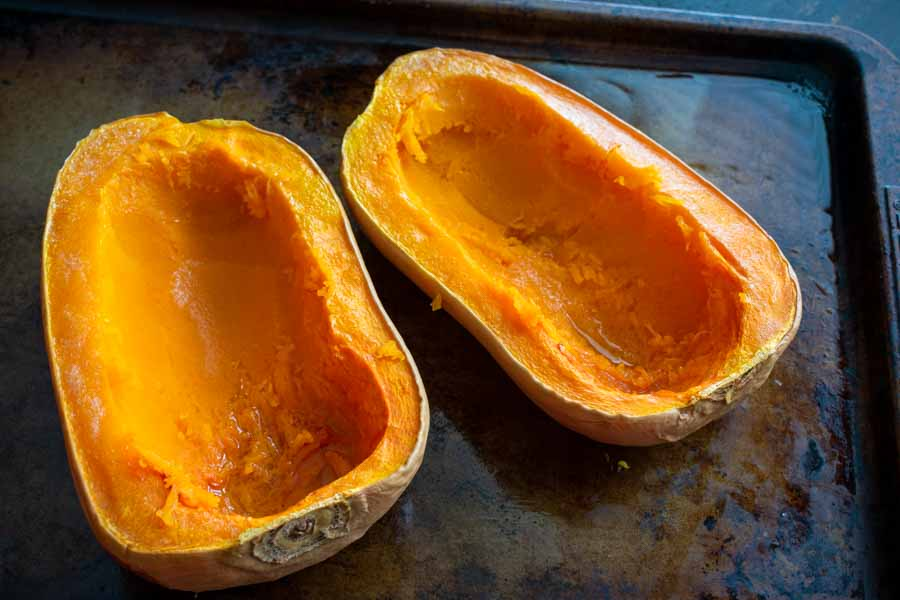 The scooped out butternut squash halves