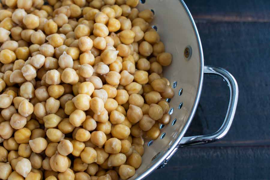 Draining the chickpeas after soaking overnight
