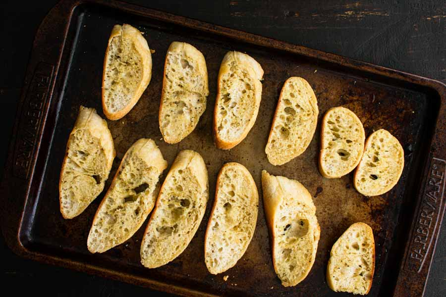 The toasted bread on a sheet pan.