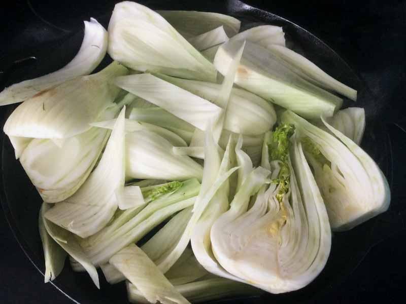 Sautéing the quartered fennel bulbs