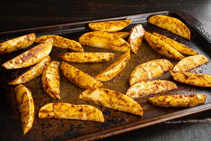 Potato wedges tossed in olive oil and spices to go with my Nando's Portuguese Chicken Burgers