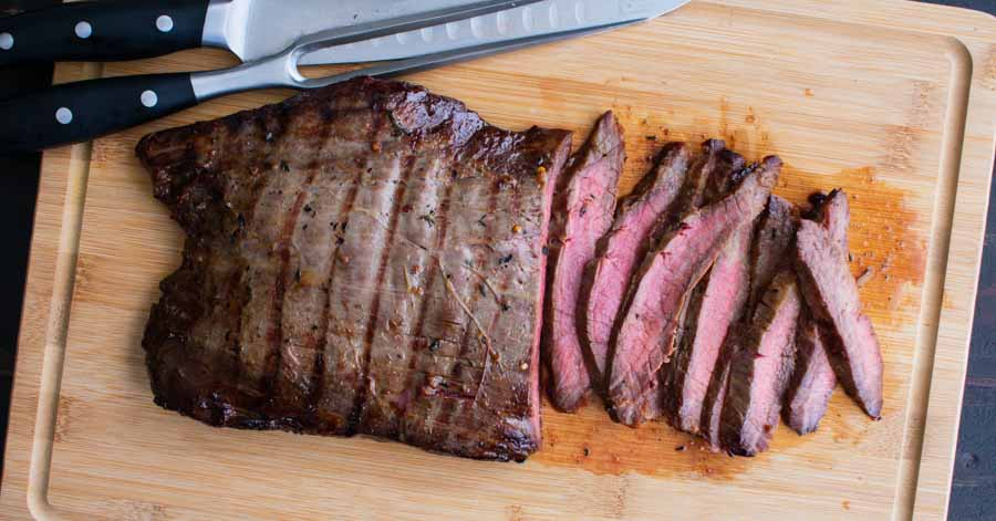 Carving the Bourbon Marinated Grilled Flank Steak
