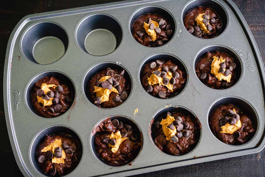 Muffin pan filled with batter