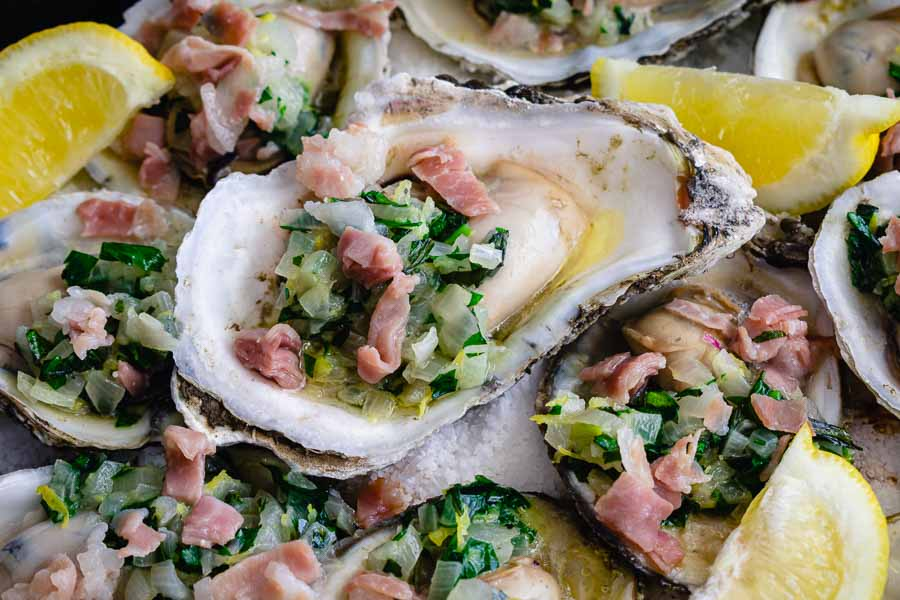 A close-up view of the finished Herb Butter Oysters with Prosciutto